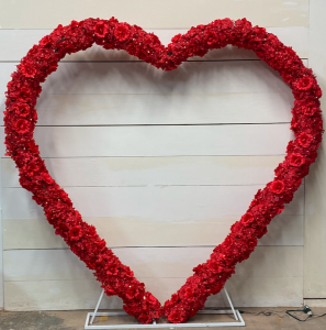oversized heart motif with red flowers wrapped around it available to rent