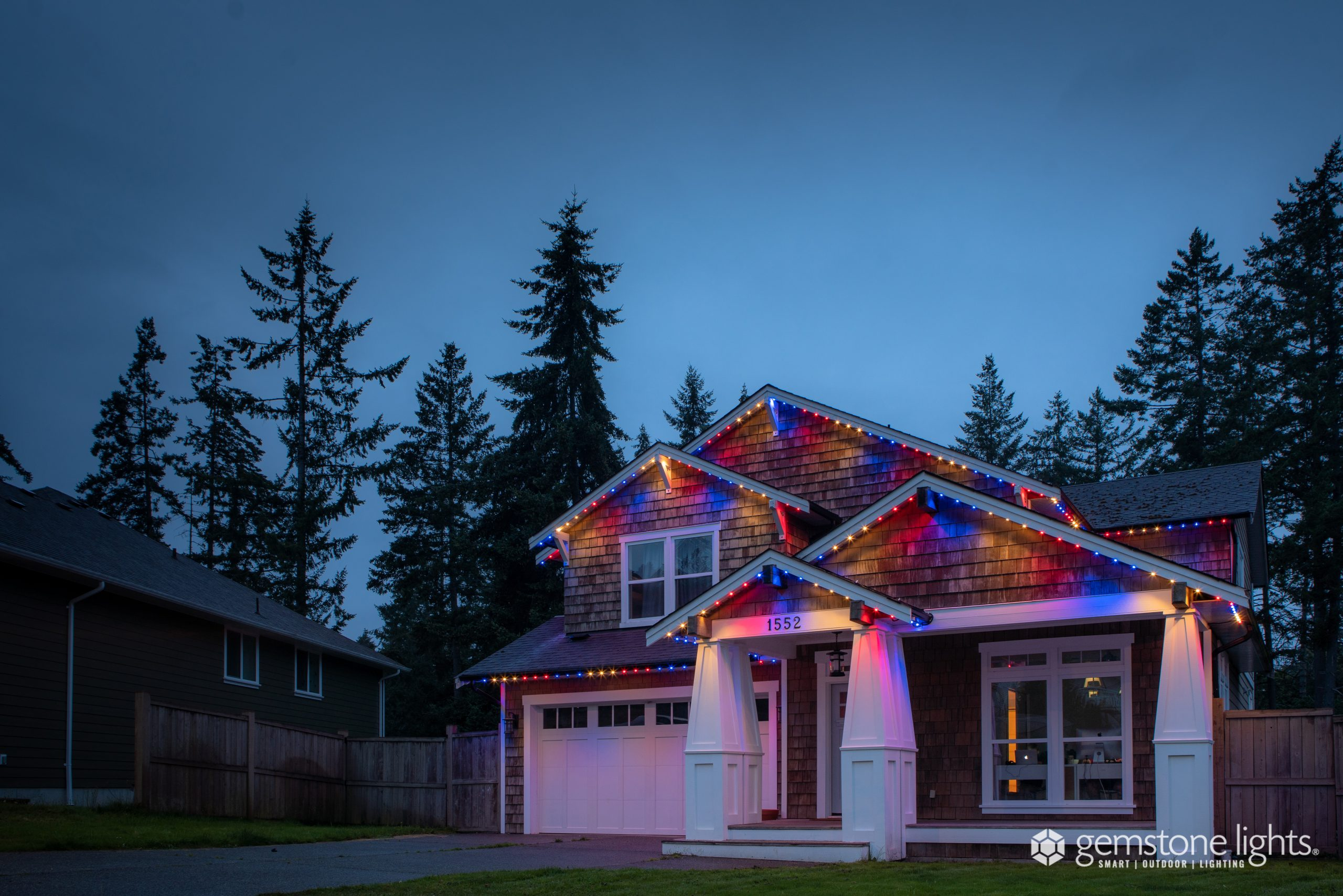 4th of july color changing soffit lights on a home